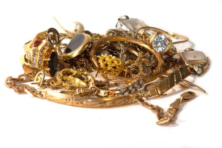 pile of old broken gold jewelry for scrap